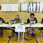 Election judges at the Community Center are from left, Oscar Murphy, Alexander Barnes, Lisa Square, and Leslie Copelin.  Photo by Eric Zhang