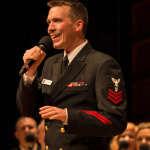Musician 1st Class Bill Edwards sings with the United States Navy - Photo by Navy Band Sea Chanters chorus during a concert at Edinboro (PA) University earlier this year.  Photo by Navy Chief Musician Melissa Bishop