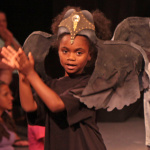 Aja Lozado sings and dances with the other elephants in the show.  Photo by Jon Gardner