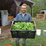 Primaterra Farms Henry Jochem shows off his produce.  Photo by Rose Monahan