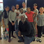 Seventh graders at Greenbelt Middle School stay after school to make a movie. Back row (from the right) Fatima Seisay, Cora Jackson, Sheila McGee and Mecca Lartique; front row (from the right) Simone Thom, Anya Wilkinson, Madeleine McComb, Chiamaka Chukwukere, Divya Chappa and Katie Delaney; front (center) Graphic Design Teacher Cortland Jones.  Photo by Julie Depenbrock