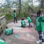 Earth squad decorating Franklin Park love bridge.  Photo by Carolyn Lambright-Davis
