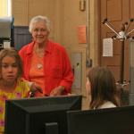 The youngest campers, called the Myrmidons, from Creative Kids Camp tour the News Review Office on June 19 and react as Editor Mary Lou Williamson suggests they volunteer to work on the paper.
