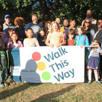 A group of students gather to celebrate their walk to school.  Photo by George Mathews