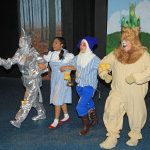 The tinman (Marie Nearing), Dorothy (Loraine Hamlett), scarecrow (Dallas DeFord) and cowardly lion (Steve Yednock) are off to see the wizard..  Photos by Jon Gardner
