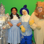 The tinman (Marie Nearing), Dorothy (Loraine Hamlett), the scarecrow (Dallas DeFord) and the cowardly lion (Steve Yednock) are off to see the wizard at Greenbelt Arts Center.  Photo by Jon Gardner