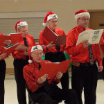 Breakfast with Santa - choral group with Leo Lion. Photo by Butch Hicks